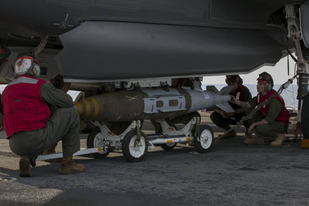 A GBU-32 Guided Bomb Unit being loaded on an F-35